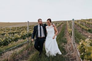 Couple walking through vines